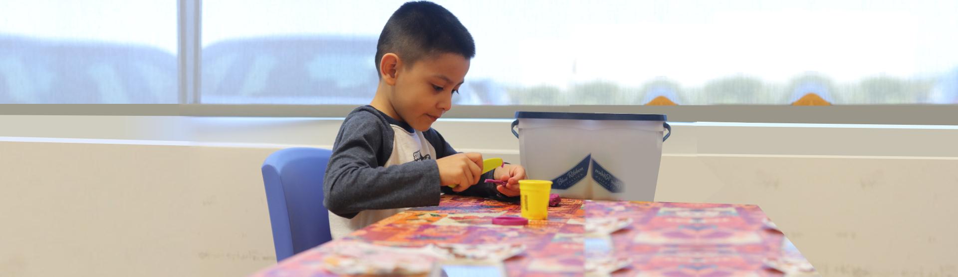 cute little boy doing his art activity
