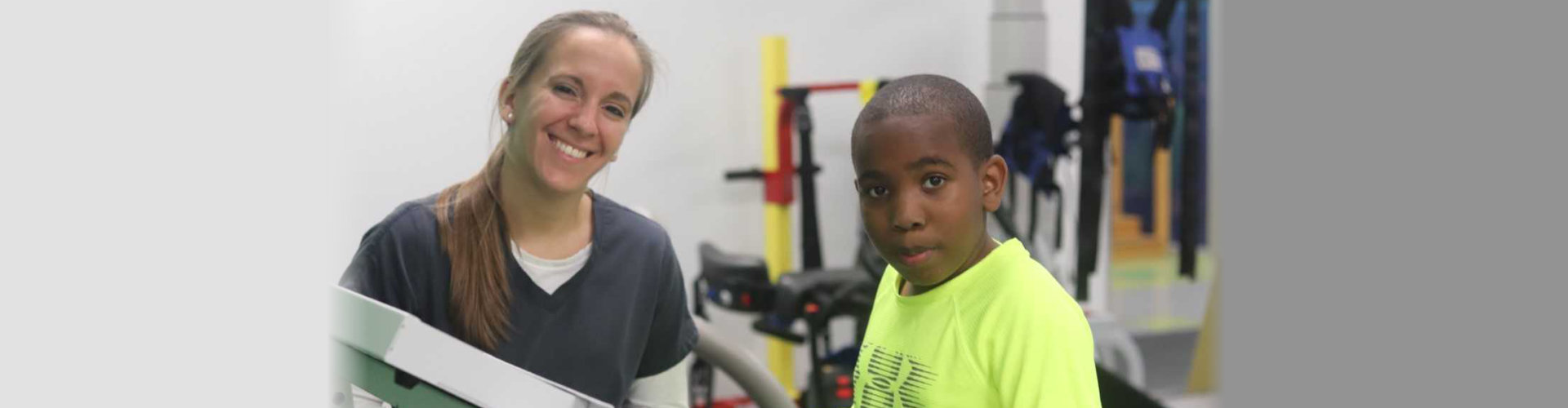 African-American boy wearing yellow shirt and a woman
